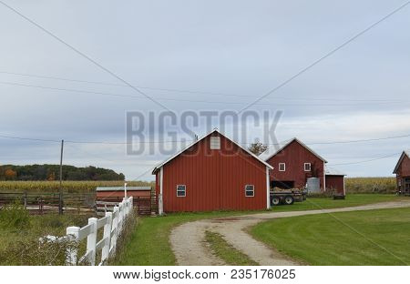 Small Family Farm And Yard With Outbuildings And Barns