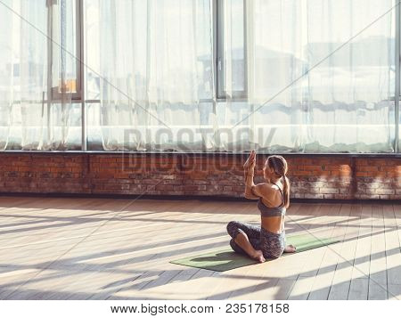 Young woman practicing yoga in a yoga class