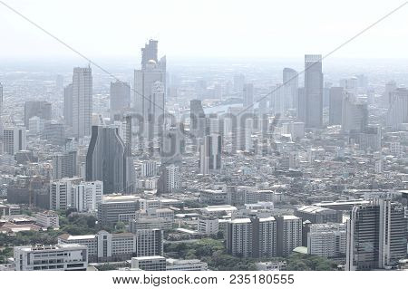 Modern Buildings In The Metropolis With A Pollution Haze In The Air