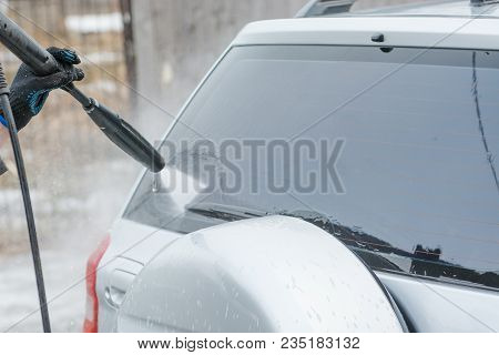 Car Wash. Wash The Car With High Water Pressure. High Water Pressure On The Car.