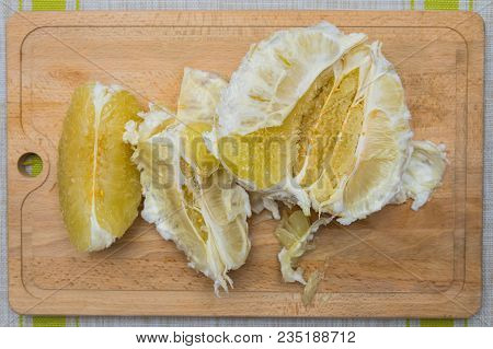 Cleansed Pomelo Lying On A Wooden Board.