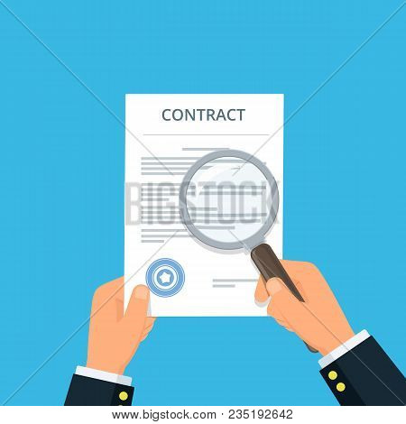 Contract Inspection For Fraud Prevention. Close-up Businessman Hands Holding Contract And Magnifying