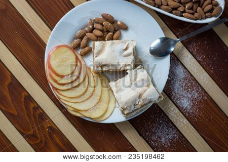 Square Shape Sliced Omemade Apple Pie With Kumquats And Almonds