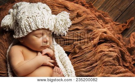 Baby Newborn Sleep In Knitted Hat, New Born Child Sleeping On Brown Blanket, Asleep Infant Kid