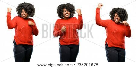 Young beautiful african plus size model happy and excited celebrating victory expressing big success, power, energy and positive emotions. Celebrates new job joyful isolated over white background.