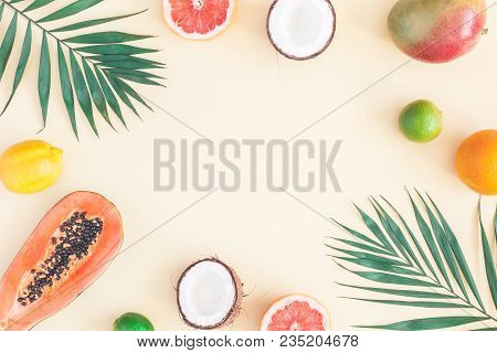 Summer Tropical Composition. Green Palm Leaves And Tropical Fruits On Pastel Yellow Background. Summ