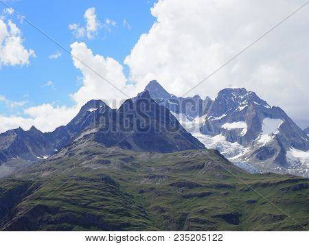 Scenic Alpine Mountains Range Landscape In Swiss Alps At Switzerland, Picturesque Rocky Scenery Seen