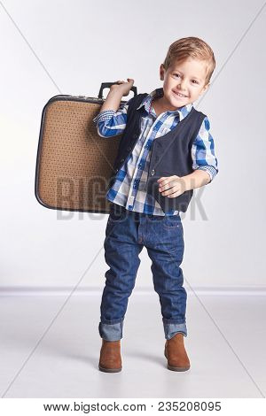 Little Boy Holding A Suitcase Going On Vacation And Travel. Summer Vacation Trip Out Of Town On Vaca