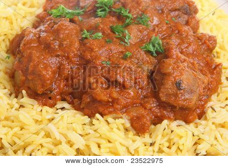 Lamb rogan josh Indian curry with pilau rice.