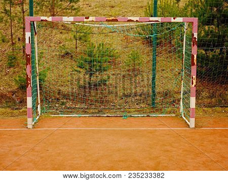Soccer Football Net Background Over Green Grass And Blurry Stadium. Close Up Detail Of A Soccer Net