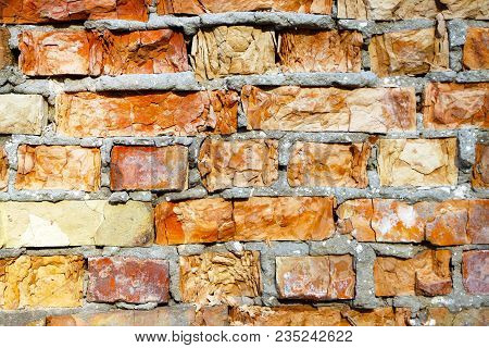 Old Destroyed Red Brick Closeup Wall Background Texture. Broken Building Stone Construction