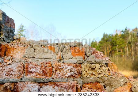 Old Destroyed Red Brick Closeup Wall Background Texture On Forest Nature Backdrop. Broken Building S