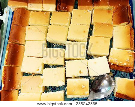 Slices Of Curd Casserole Are On A Tray. Cottage Cheese Casserole With A Spoon