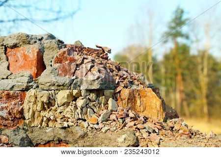 Old Destroyed Red Brick Wall Background Texture On Forest Nature Backdrop. Broken Building Stone Con