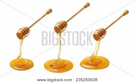 Set Of Wooden Dippers With Dripping Honey Isolated On White Background. Package Design Element