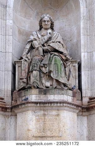 PARIS, FRANCE - JANUARY 04: The statue of Esprit Flechier by Louis Desprez, Fountain of the Sacred Orators, Place Saint-Sulpice in Paris, France on January 04, 2018.