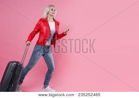 Happy Young Woman With Travel Suitcase With Mobile Phones. Blonde Tourist Girl On Pink Background, C
