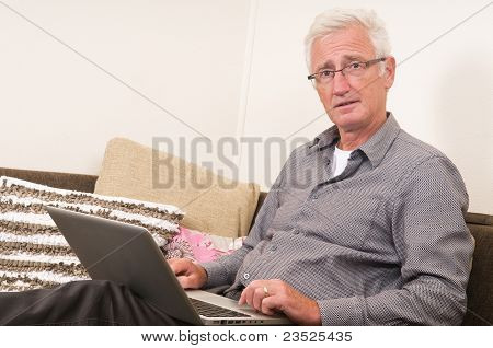 Senior Working On A Laptop