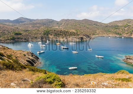 Boats And Sailboats Moored In A Small Bay In The Cap De Creus Natural Park, The Westernmost Point Of
