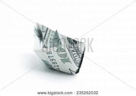 Boat Made Origami From Dollar Bills.isolated On A White Background.photo With Copy Space