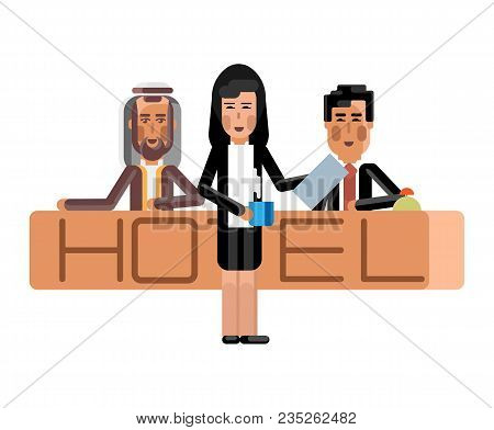 Arabic And Asian Receptionists At Hotel Reception Desk And Secretary With Coffee Cup. Corporate Mult