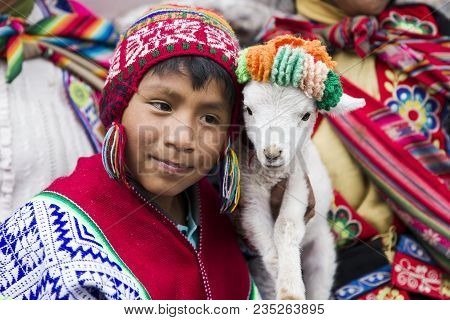 Cusco, Peru - December 31, 2017: Unidentified Boy On The Street Of Cusco, Peru. Almost 29% Of Cusco
