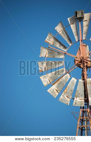 Detail Spinning Windmill On Summer Day With Clear Sky