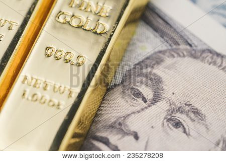 Shiny Gold Bullions Ingot Stack On Japanese Yen Banknote Money As Financial Asset, Investment And We