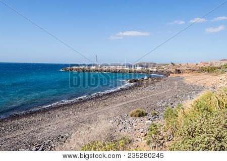 View Of The Coast And Marina Of Los Abrigos In The South East Of The Island Of Tenerife In Spain