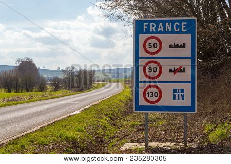 Road Sign Of Return To The French Territory With Different Speed Limits Along The Roads.