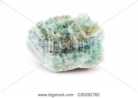 Light Colored Gem Rock Stone Against An Isolated White Background.