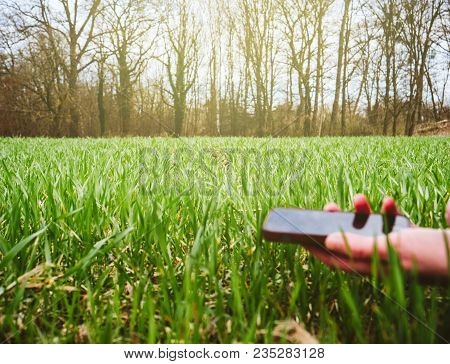 Defocused Hand Of Young Agronomist Agriculture Woman Biologist Using Moden Mobile Technology To Insp