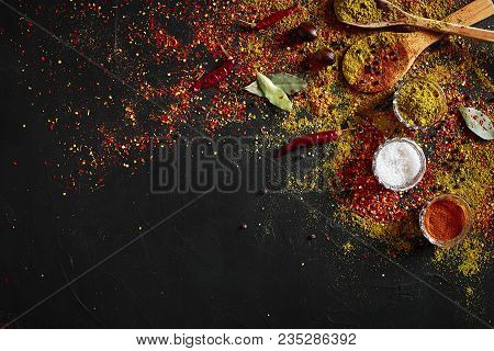 Assorted Spices On Dark Black Background. Seasonings For Food. Curry, Paprika, Pepper, Cardamom, Tur
