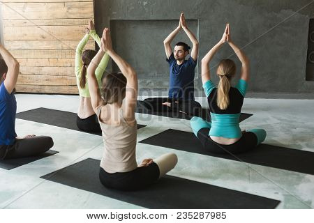 Yoga Teacher And Beginners In Class, Making Asana Exercises. Lotus Pose. Healthy Lifestyle In Fitnes