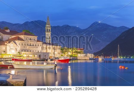 Night Panoramic View Of Perast Old Town With Famous Campanile Of St. Nikola Church On The Bay Of Kot