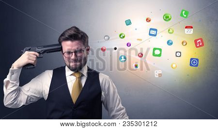 Man shoots his head with gun and application icons coming out from his head