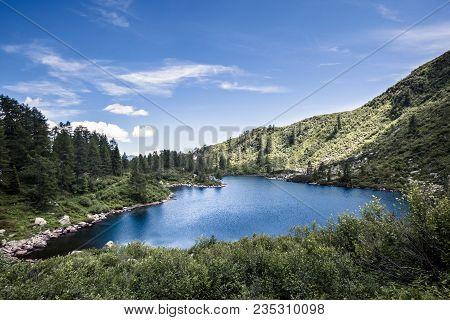 Blue Lake In Italian Mountains, Symbol Of Italian Mountain Landscape, Nice Lake In Mountains Overloo