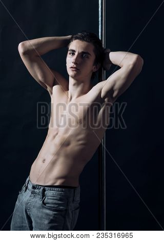 Sexy, Attractive Guy Lean On Metallic Pole. Macho With Naked Chest, Athlete, Sportsman, Dancer Perfo