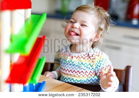 Adorable Cute Beautiful Little Baby Girl Playing With Educational Toys At Home Or Nursery. Happy Hea