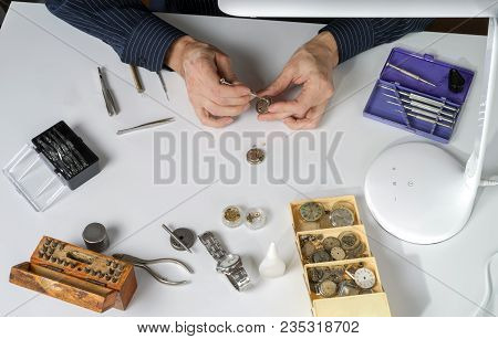 The Watchmaker Is Repairing The Mechanical Watch. Workplace Of The Clockmaker For The Repair Of Mech