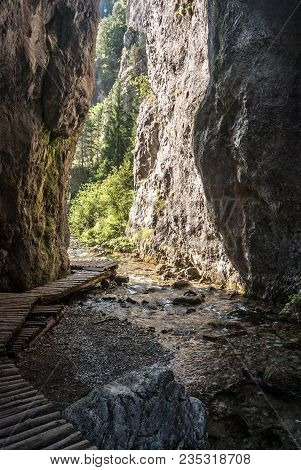 Narrow Enter To Prosiecka Dolina Valley Named Vrata With Steep Rocka, Stream And Hiking Trail In Cho