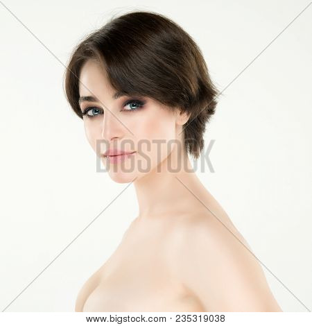 Beauty female portrait. Young attractive woman posing at studio over white background. Beautiful girl. Model with perfect make-up