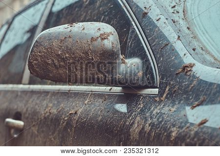 Close-up Image Of A Dirty Car After A Trip Around The Countryside.