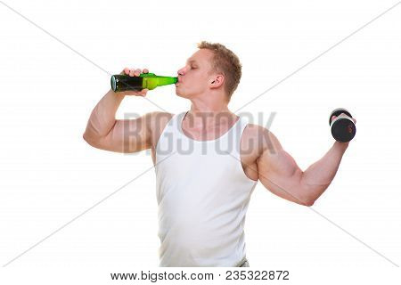 Fat Man With A Bottle Of Beer Holds Dumbbells Isolated On White. The Concept Of Choosing Between Har