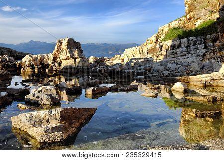 Nice Cliffs At Kassiopi Beach In Corfu, Greece