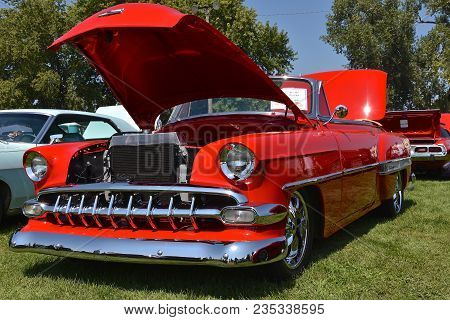 Yankton, South Dakota, August 19, 2017: The Restored Classic Red 1954 Chevy Belair  Convertible Is D