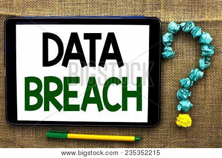 Conceptual hand writing showing Data Breach. Business photo text Stolen Cybercrime Information Hacking Security Malicious Crack written Tablet the jute background Pen next to it Ask for. poster