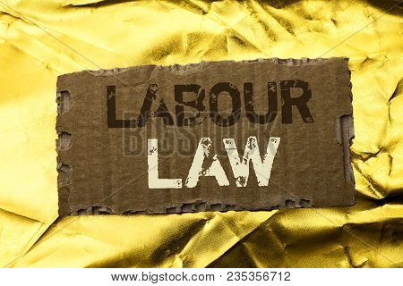 Word writing text Labour Law. Business concept for Employment Rules Worker Rights Obligations Legislation Union written tear Cardboard Piece the Golden textured background. poster