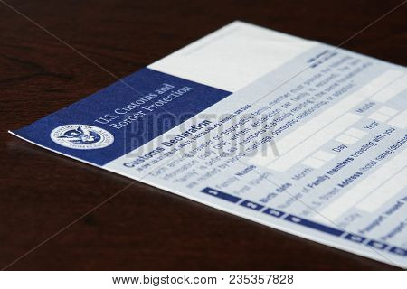 New York, Usa - April 9, 2018: Customs Declaration Form Laying On Wooden Table Close-up