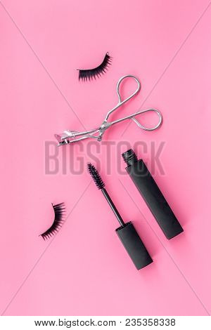 Cosmetics And Tools For Voluminous Lashes. Mascara, False Eyelashes, Eyelash Curler On Pink Backgrou